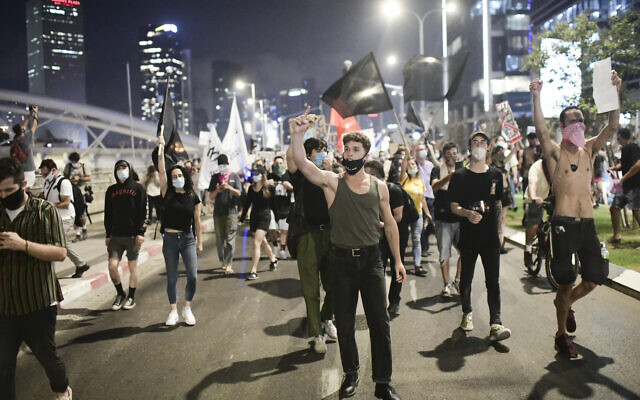 Israelis protest against Public Security Minister Amir Ohana in Tel Aviv, on July 28, 2020 (Tomer Neuberg/Flash90)