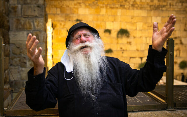 A Jewish man  at the Western Wall in the Old City of Jerusalem, on July 29, 2020. (Olivier Fitoussi/Flash90)