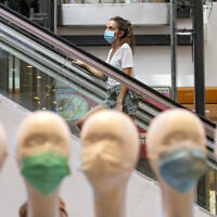 Jerusalemites, wearing face masks for fear of the coronavirus, shop at the Malha Mall in Jerusalem in Jerusalem on July 29, 2020.  (Olivier Fitoussi/Flash90)