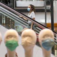 Jerusalemites, wearing face masks for fear of the coronavirus, shop at the Malha Mall in Jerusalem in Jerusalem on July 29, 2020.  (Olivier Fitoussi/Flash90)