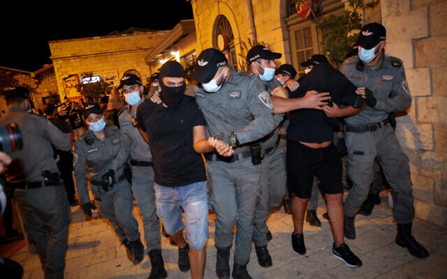 Illustrative: Police arrest La Familia soccer hooligans at the First Station in Jerusalem on July 30, 2020. (Olivier Fitoussi/Flash90)