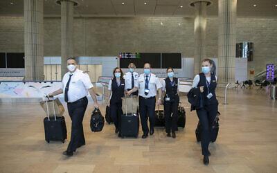 An El Al crew arrives at Ben Gurion airport on June 12, 2020. (Olivier Fitoussi/Flash90)