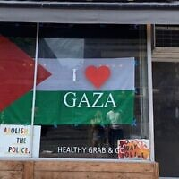 Foodbenders store owned by Kimberly Hawkins, with a pro-Palestinian banner in the window. (Foodbenders/Instagram via JTA)