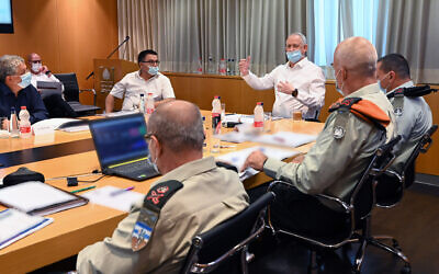 Defense Minister Benny Gantz meets with senior defense officials on July 2, 2020 to discuss mobilization of reservists in the wake of a surge of COVID-19 cases. (Ariel Hermoni/Ministry of Defense)