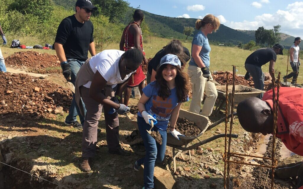 Hannah Alper helps build a new high school in Kenya as part of a service trip with the organization Me to We, in June 2016. (Courtesy)