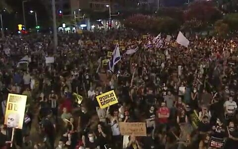 Israelis attend a protest in Tel Aviv's Rabin Square against the government's economic policies during the coronavirus pandemic, July 11, 2020. (Screen capture: Channel 12)