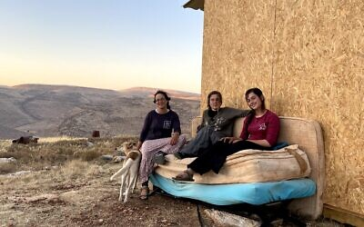 (From L-R) T'heeya Gozlan, Ora Hodaya and Shalhevet Goldstein in the Maoz Esther outpost on July 12, 2020. (Jacob Magid/Times of Israel)
