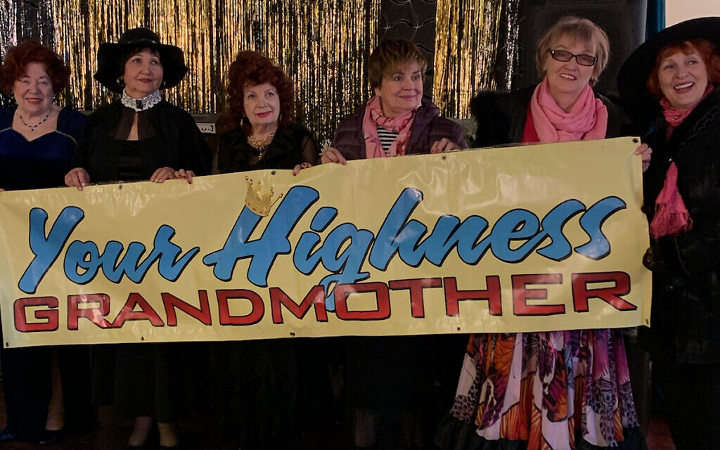 Your Highness Grandmother Pageant contestants hold up banner. (Gosha Shif/Be Proud Foundation)