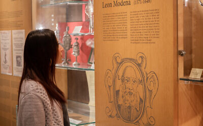 A visitor looks at an exhibit in the Jewish Museum of Venice. (Credit: Porcel)