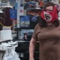 Screen capture from video of a man and woman wearing swastika face masks as they shop at a Walmart in Minnesota, July 25, 2020. (Facebook)