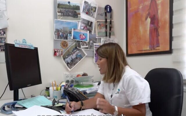 Screen capture from video of a nurse at the Ramle Health Office conducting an epidemiological investigation with a known virus carrier. (Channel 12 news)