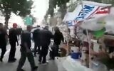 Screen capture from video of municipal workers clearing away a protest site from near the prime minister's official residence in Jerusalem, July 12, 2020. (Twitter)