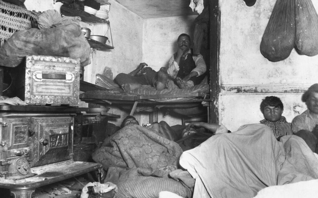 Illustrative photo of immigrants in a New York tenement. (Bettmann/Getty Images)