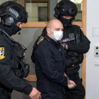 Stephan Balliet (C), who is accused of shooting dead two people after attempting to storm a synagogue in Halle an der Saale, eastern Germany, is escorted to a courtroom at the second day of his trial on July 22, 2020, in Magdeburg, eastern Germany. (Hendrik Schmidt POOL/ AFP)