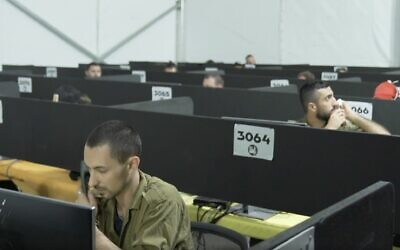 Illustrative: In a video released by the Israel Defense Forces on July 29, 2020, soldiers man the phones at the IDF Home Front Command's headquarters during a visit by coronavirus czar Prof. Ronni Gamzu. (Screen capture: Israel Defense Forces)