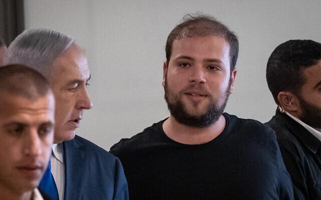 Topaz Luk, social media adviser to Prime Minister Benjamin Netanyahu, arrives with the premier at the Knesset, September 15, 2019. (Yonatan Sindel/Flash90)