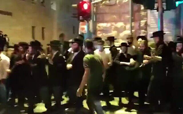 Ultra-Orthodox protesters clash with police in Jerusalem over the arrest of a yeshiva student, July 22, 2020. (Screenshot/YouTube)
