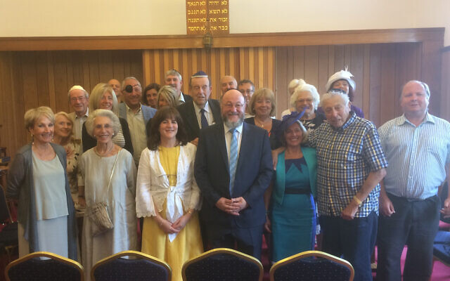 Britain's Chief Rabbi Ephraim Mirvis, center, visits the Jersey Jewish Congregation in 2017. (Courtesy/Jersey Jewish Congregation via JTA)