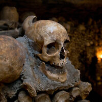 Illustrative: A skull in the catacombs of Paris, France, on October 14, 2014. (AP Photo/Francois Mori)