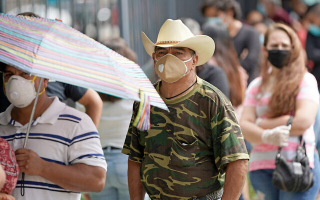 People wait in line at a free COVID-19 testing site provided by United Memorial Medical Center, at the Mexican Consulate in Houston, Texas, June 28, 2020. (AP Photo/David J. Phillip)