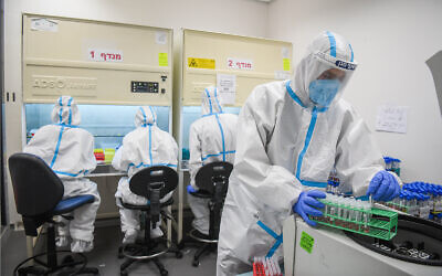 Illustrative: Technicians carry out a diagnostic test for coronavirus in a lab at a Meuhedet Health Services branch in Lod, July 2, 2020. (Yossi Zeliger/Flash90)