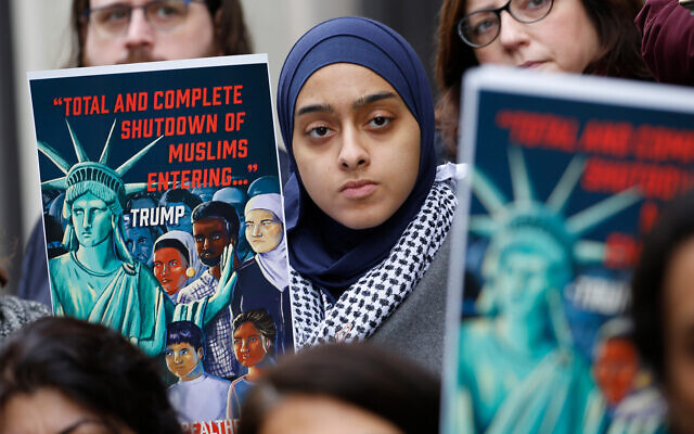 Demonstrators listen to speakers during a rally outside the US 4th Circuit Court of Appeals as it hears arguments on US President Donald Trump's ban against Muslim-majority countries, in Richmond, Virginia, January 28, 2020. (AP Photo/Steve Helber)