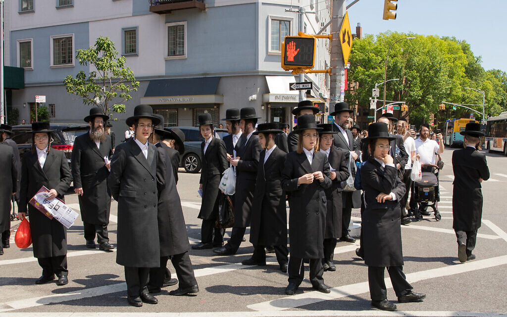 Williamsburg residents look on as protesters pass through their Brooklyn neighborhood, June 12, 2020. (Avi Kaye via JTA)