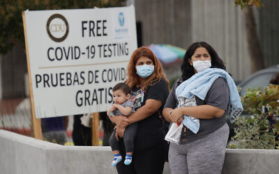 People wait to take a coronavirus test at a mobile testing site in Los Angeles, California, July 22, 2020. (AP Photo/Marcio Jose Sanchez)