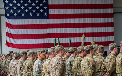 US soldiers stand in formation during a military ceremony at the Storck barracks in Illesheim, Germany, March 9, 2017. (Nicolas Armer/dpa via AP)