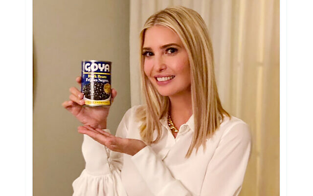 """This image taken from Ivanka Trump's Twitter account shows her holding a can of Goya beans along with the words """"If it's Goya, it has to be good"""" written in English and Spanish. (Ivanka Trump's Twitter page via AP)"""