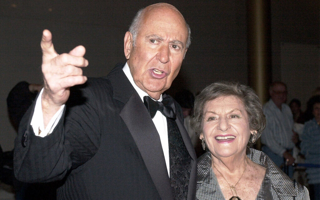 Carl Reiner is accompanied by his wife Estelle as they enter the Kennedy Center in Washington, October 24, 2000. (AP Photo/Stephen J. Boitano, file)