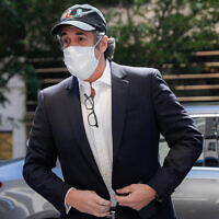 Michael Cohen arrives at his Manhattan apartment in New York after being furloughed from prison because of concerns over the coronavirus, on May 21, 2020. (AP Photo/John Minchillo, File)