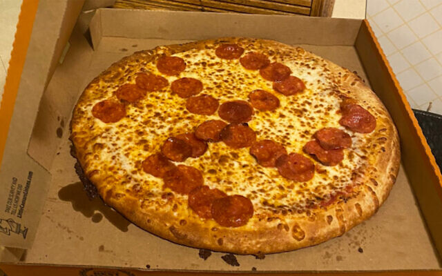 A Little Caesars pizza with a pepperoni swastika delivered to a couple in Ohio, June 28, 2020. (Misty Laska/Twitter via JTA)