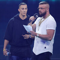 Rappers Farid Bang, left, and Kollegah, right, speak on stage during the Echo Award show at Messe Berlin on April 12, 2018 in Berlin, Germany. (Photo by Andreas Rentz/Getty Images)