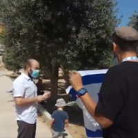 A Jewish activist waves an Israeli flag at the Temple Mount compound on Tisha B'Av, July 30, 2020. (Screen capture: Twitter)