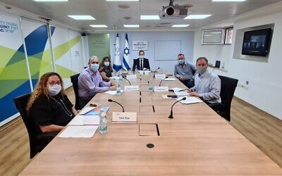 Jewish Agency head Isaac Herzog, center, with some of the organization's top leadership in its 'situation room' for a briefing on Diaspora Jewry in the COVID-19 crisis, July 8, 2020. (Courtesy Jewish Agency)