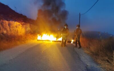 Far-right activists clash with Border Police at the Kumi Ori outpost near Yitzhar in the West Bank on July 10, 2020. (Border Police)