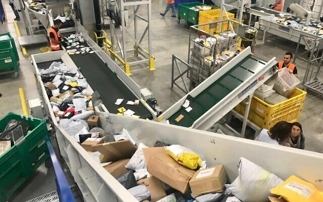 Israel Postal Company has the capacity to sort some 100 million packages a year (Courtesy)