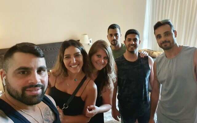 A group of new friends and fellow corona sufferers staying at the Nahariya Carlton, a government-funded convalescence home during the 2020 coronavirus (Courtesy Bar Sheffer)