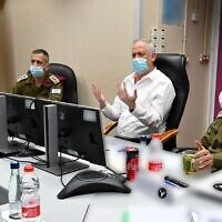 From left, Military Intelligence chief Maj. Gen. Tamir Hayman, IDF Chief of Staff Aviv Kohavi, Defense Minister Benny Gantz and Northern Command chief Maj. Gen. Amir Baram meet in IDF Northern Command headquarters in Safed on July 26, 2020. (Ariel Hermoni/ Defense Ministry)