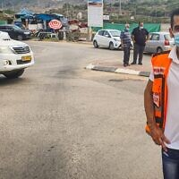 Dr. Muhammad Isa standing near the car in which 4-year old Muhammad Khalil was found. (United Hatzalah)