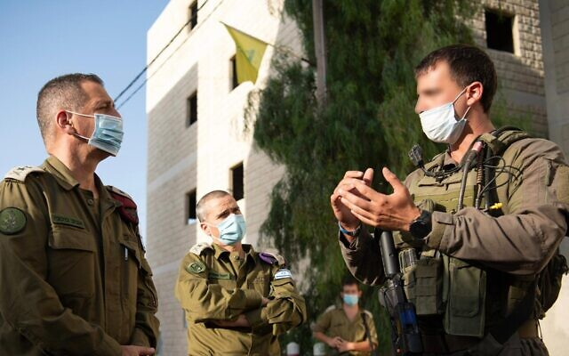 IDF Chief of Staff Aviv Kohavi, left, speaks to soldiers from the IDF's Ghost Unit as they take part in a weeks-long training exercise in July 2020. (Israel Defense Forces)