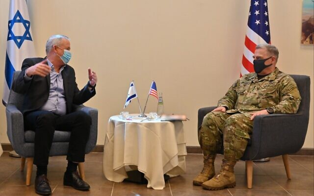 US Chairman of the Joint Chiefs of Staff Gen. Mark Milley (right) meets with Defense Minister Benny Gantz at Nevatim Air Base, July 24, 2020 (IDF)