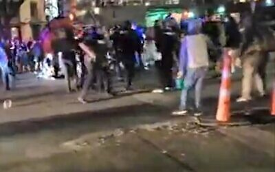 The scene after a protester who was apparently armed with a rifle at a demonstration against police violence was shot and killed after he approached a vehicle that had driven through the crowd and the driver opened fire, July 25, 2020 (Screen grab/abc7)