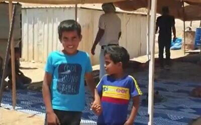 Ayman (L) and Muhammad al-Jahalin who were in a video made by children's entertainer 'Roy Boy,' July 13, 2020 (Screen grab/Channel 13 news)