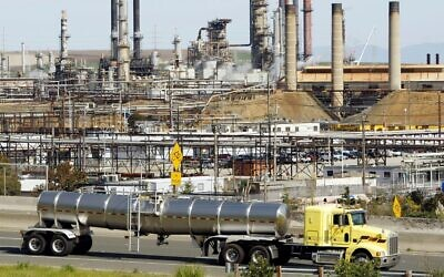 A tanker truck passes the Chevron oil refinery in Richmond, California, on March 9, 2010. (AP Photo/Paul Sakuma, File)