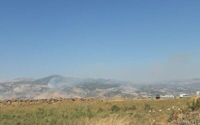 Smoke rises from a fire sparked by Israel near the contested Mount Dov area, along the Israel-Lebanon border on July 22, 2020. (Hezbollah media)
