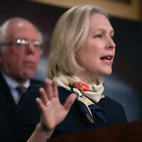 US Sen. Kirsten Gillibrand (R) speaks as Sen. Bernie Sanders (L) looks on during a news conference at the US Capitol on March 14, 2017 in Washington, DC. (Justin Sullivan/Getty Images)