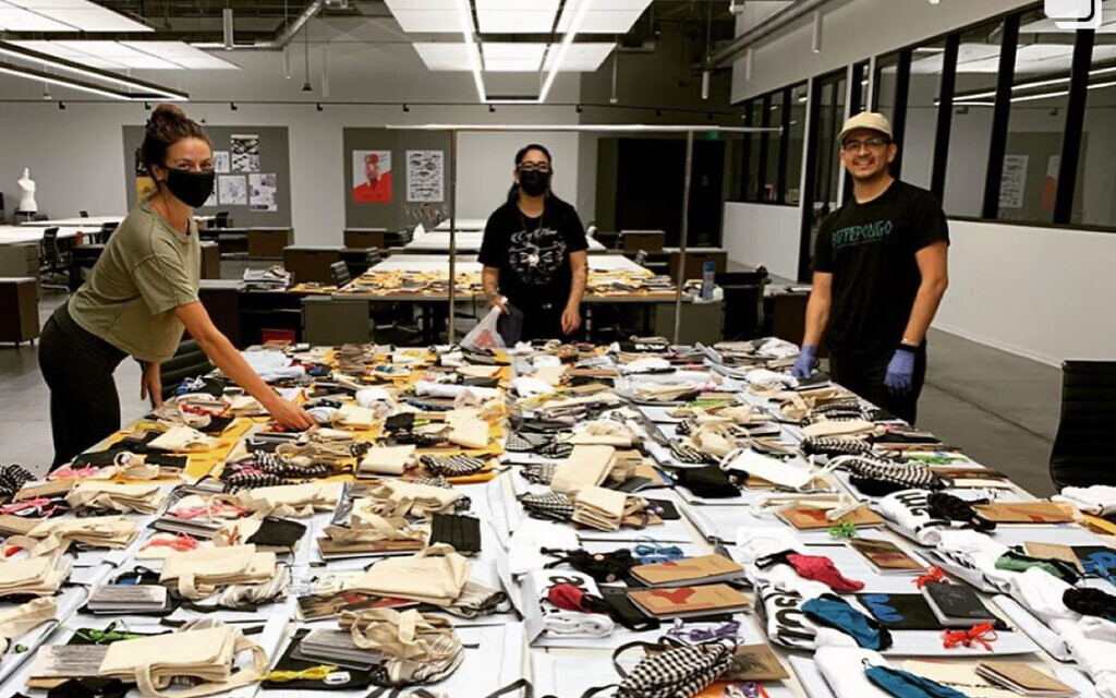 Volunteers with the Skid Row Arts Alliance put together arts care packages. (William Warrener)