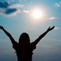 A woman enjoys sunshine, a source of vitamin D. (iStock)